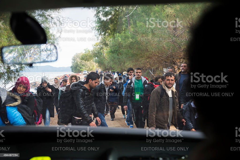 Crowd of migrants arriving on Lesbos, Greece stock photo