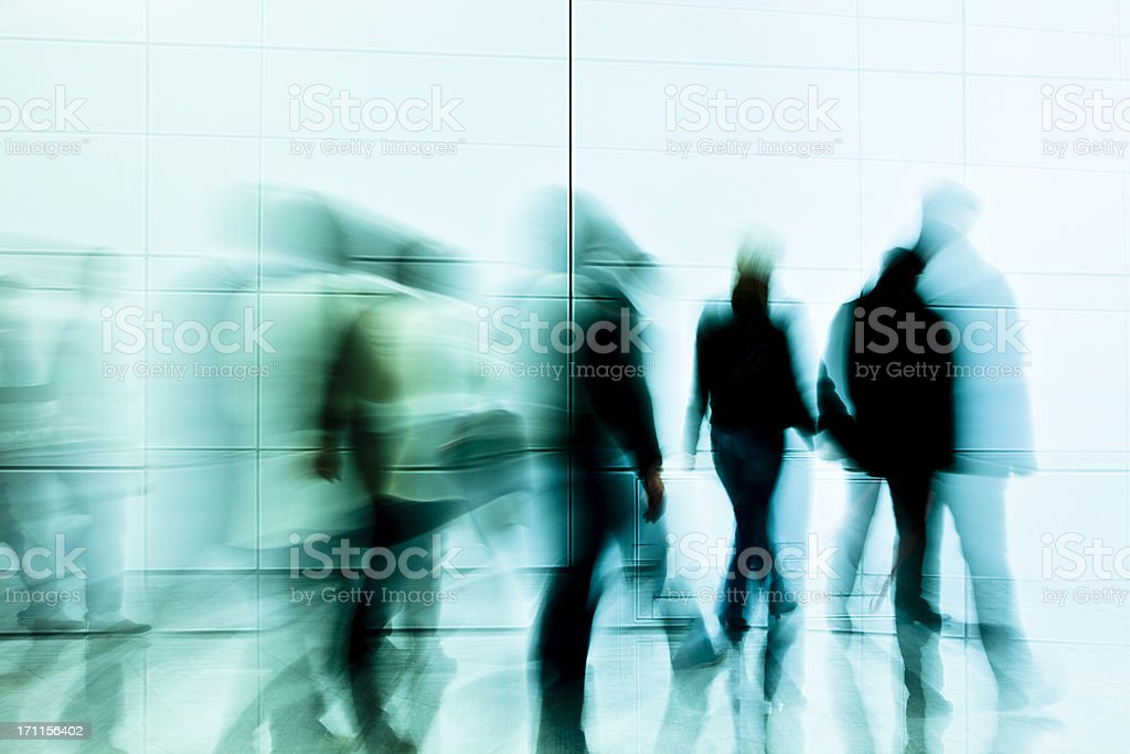 Crowd Of Motion Blurred Commuters Indoors royalty-free stock photo