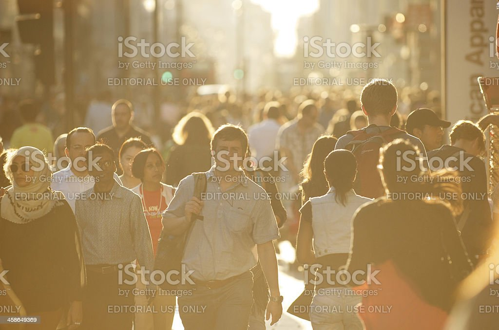 Crowd of Pedestrians Walk Along Bright London Sidewalk royalty-free stock photo