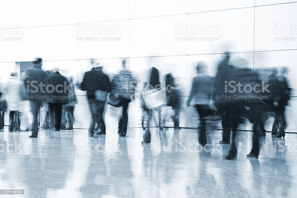 Crowd of Pedestrians Walking Indoors, Blurred Motion royalty-free stock photo