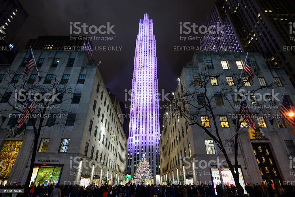 Crowd of people admire Christmas decorations in NYC stock photo