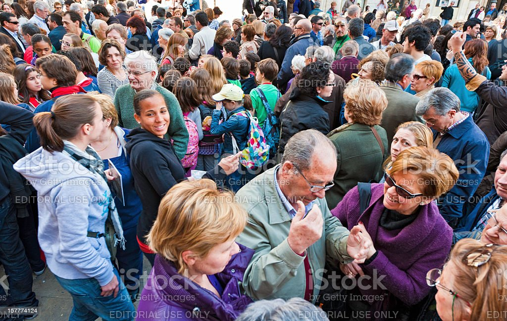 Crowd of people all ages busy city square Valencia Spain stock photo