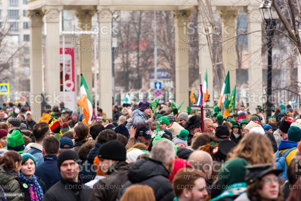 Crowd of People at a park on St.Patrick's day in Moscow stock photo