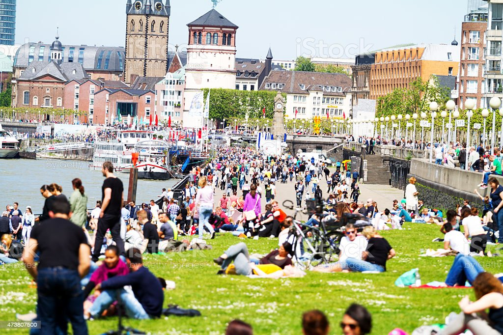 Crowd of people at Rhine and promenade in Düsseldorf stock photo