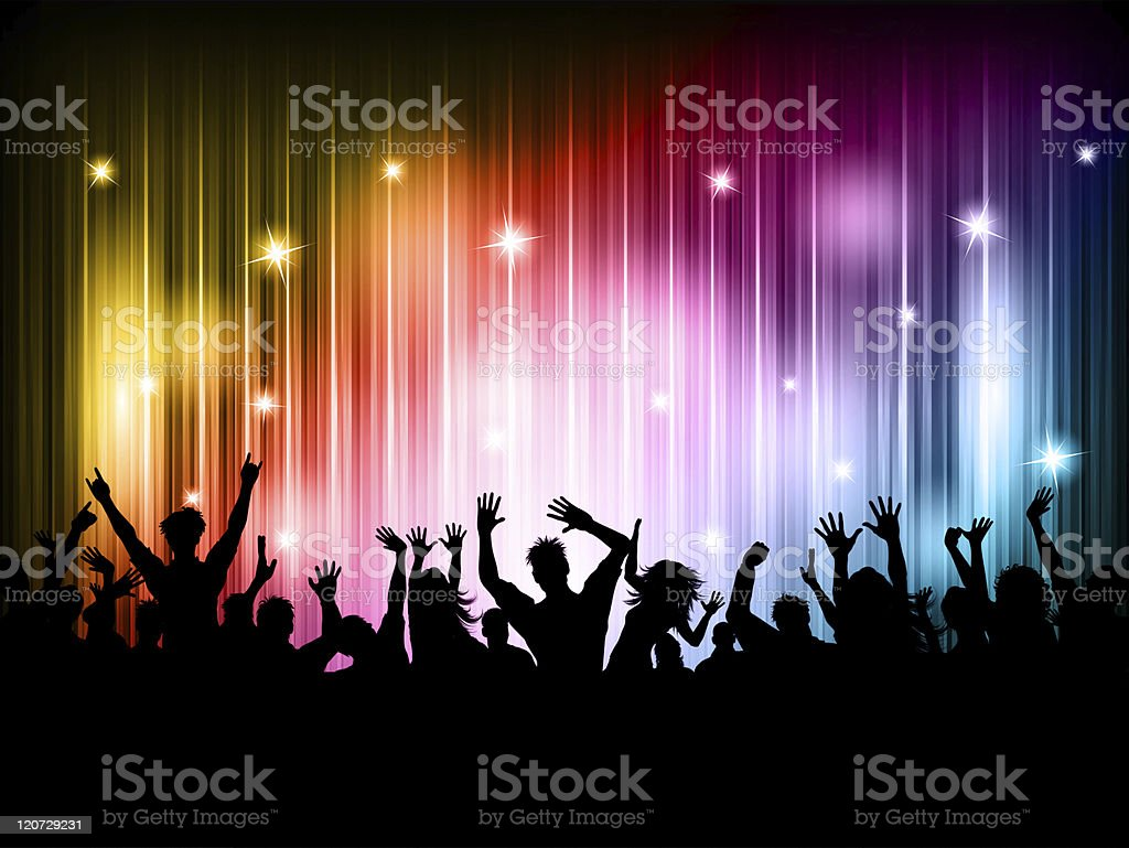 Crowd of people dancing on a colorful background stock photo