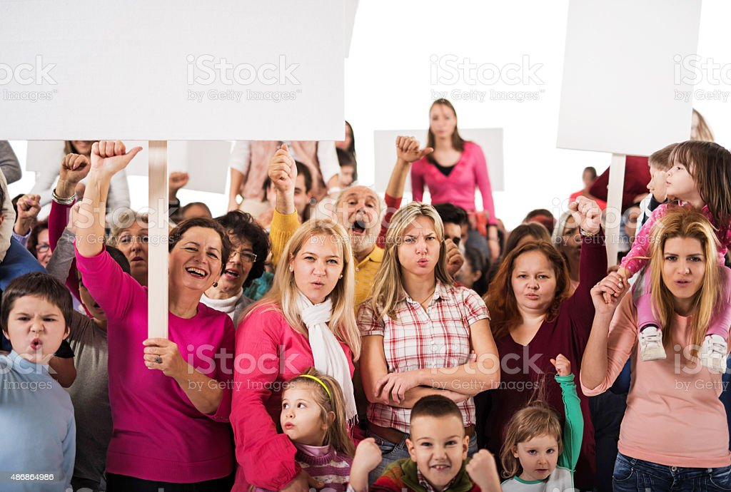 Crowd of people holding white banners and looking at camera. stock photo