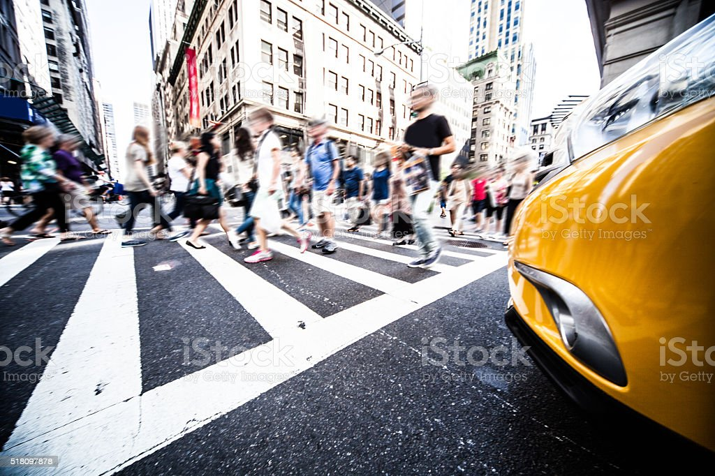 Crowd of people in downtown commercial streets stock photo