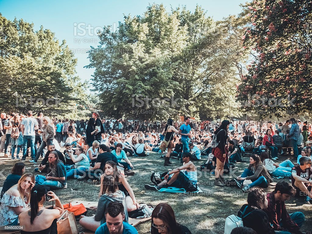 Crowd of People in park stock photo