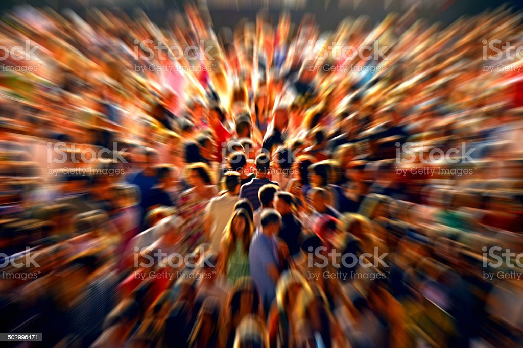 Crowd of people on street with zooming effect stock photo