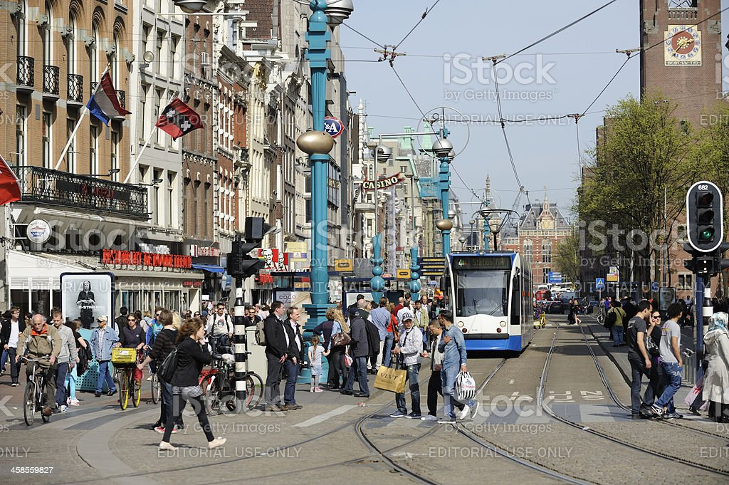 Crowd of people on the Damrak, Amsterdam royalty-free stock photo