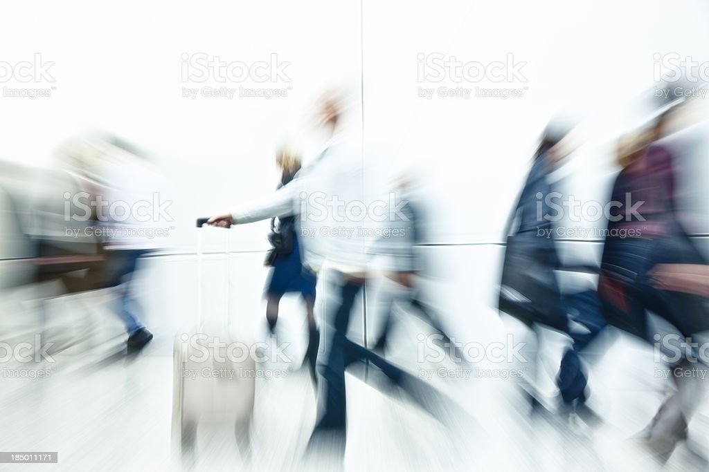 Crowd of People Rushing, White Background, High Key, Blurred Motion royalty-free stock photo