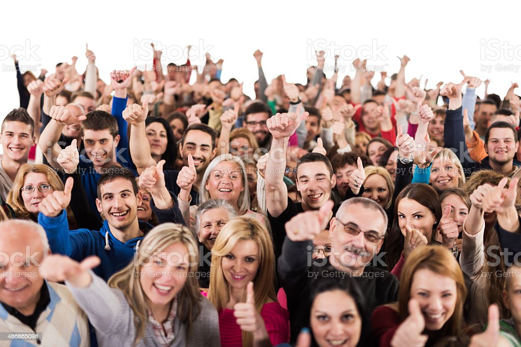 Crowd of people showing thumb up and looking at camera. stock photo