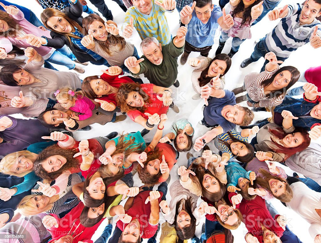 Crowd of people showing thumbs up. stock photo