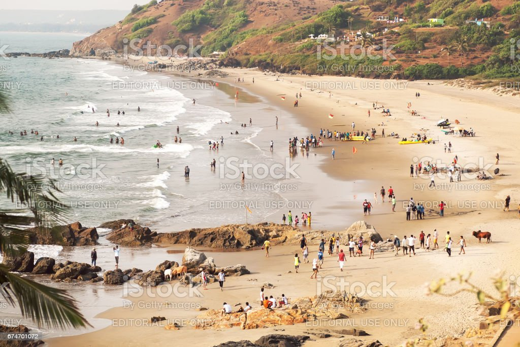 Crowd of people swimming and chilling on beautiful ocean beach stock photo