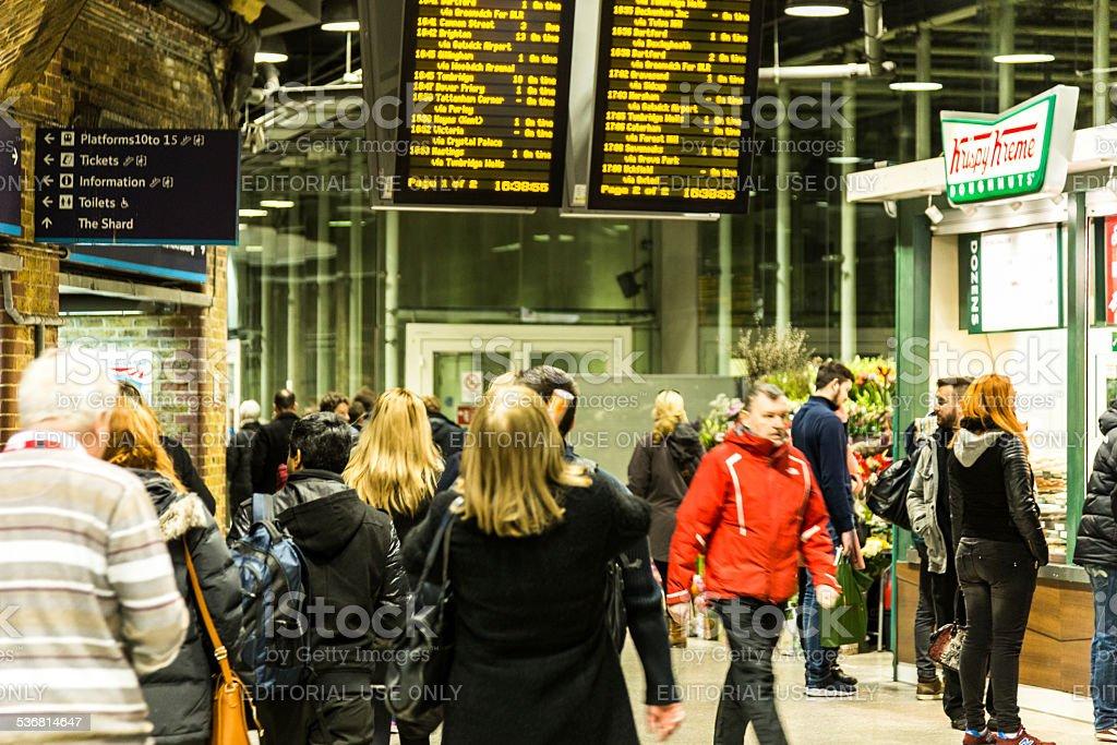 Crowd  of people waiting at London Bridge railway station stock photo