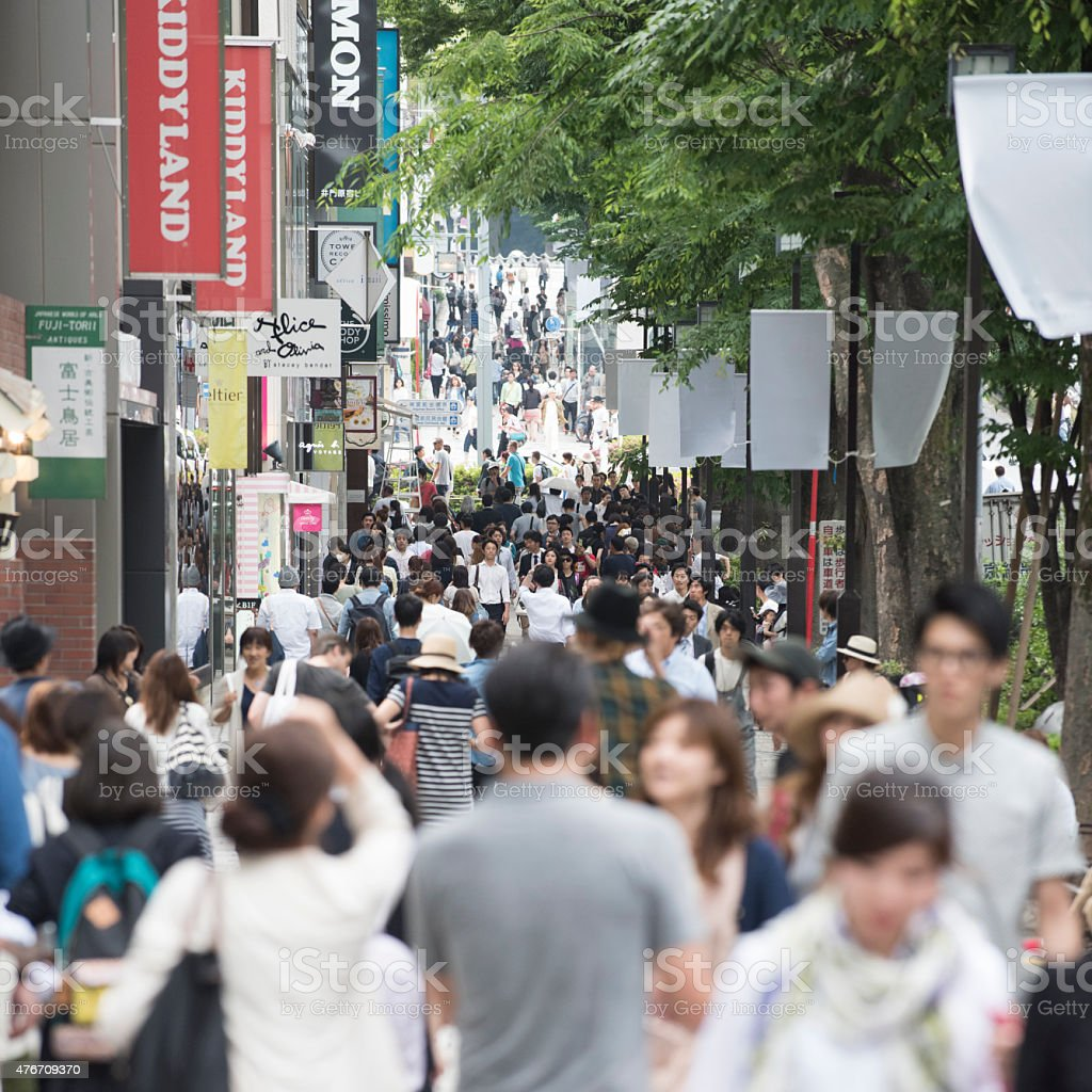Crowd of people walking in Tokyo along Omotesando stock photo