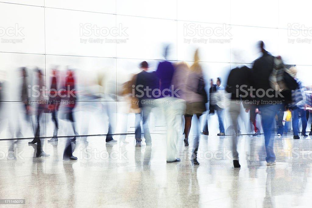 Crowd of People Walking Indoors Down Walkway, Blurred Motion stock photo