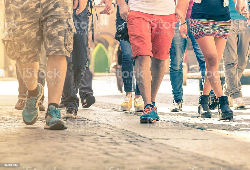 Crowd of people walking on the street stock photo