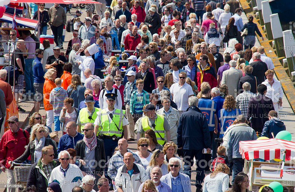 Crowd of people walking stock photo