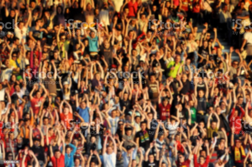 Crowd of people with raising hands stock photo