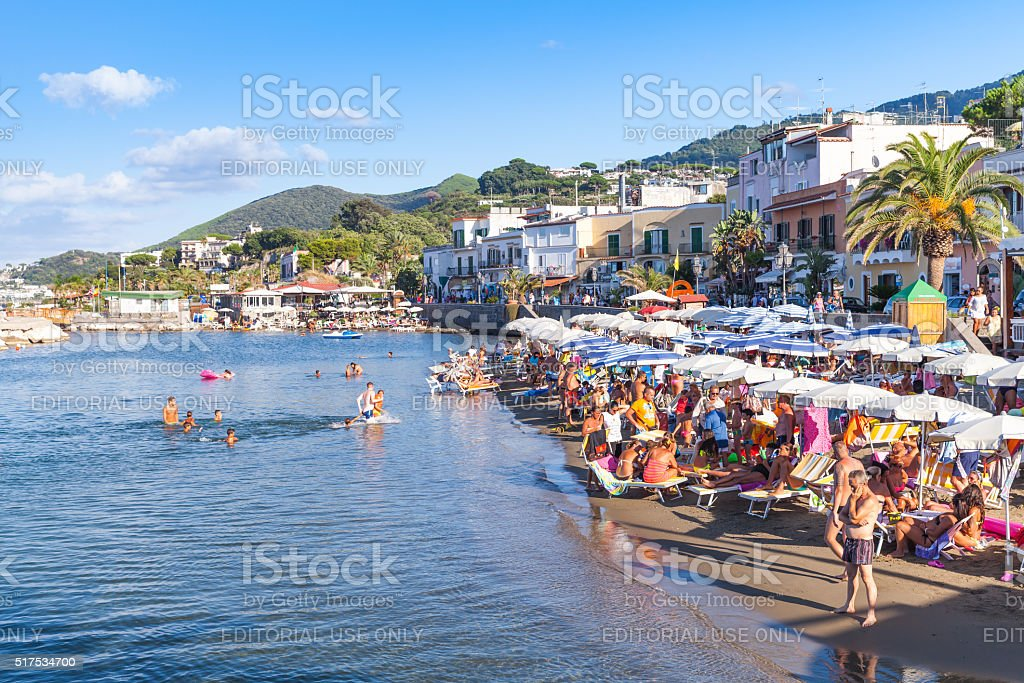 Crowd of resting tourists on Public beach, Ischia stock photo