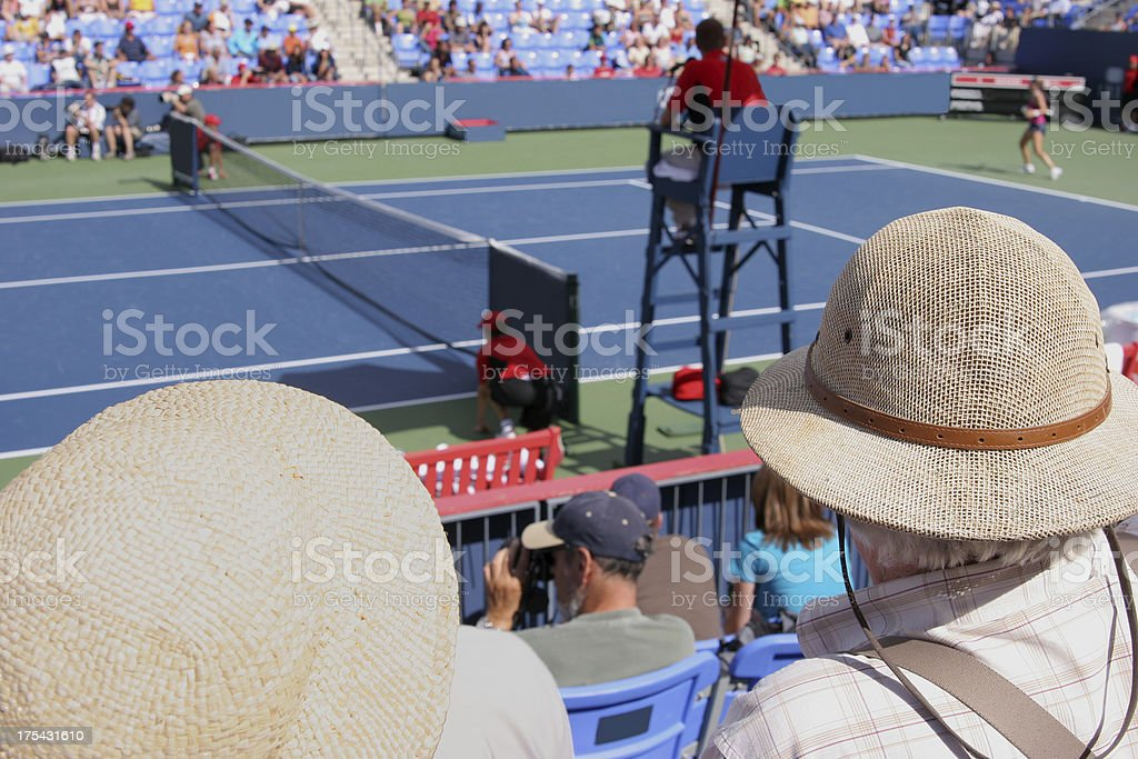 A crowd of tennis fans watching the game stock photo