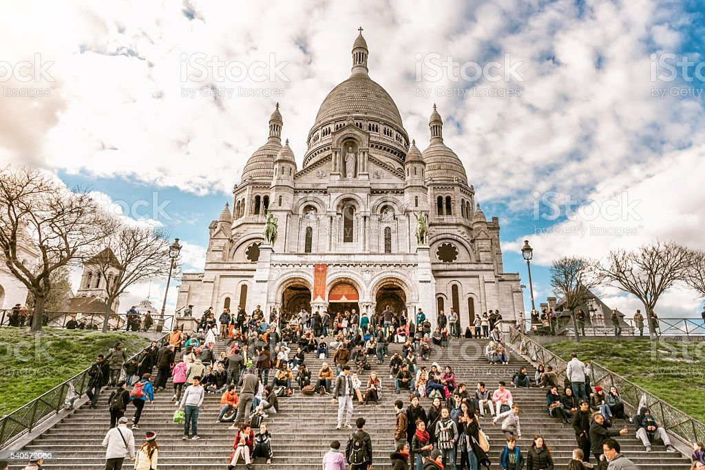 crowd of tourists on Sacre Coeur stairs in Paris stock photo