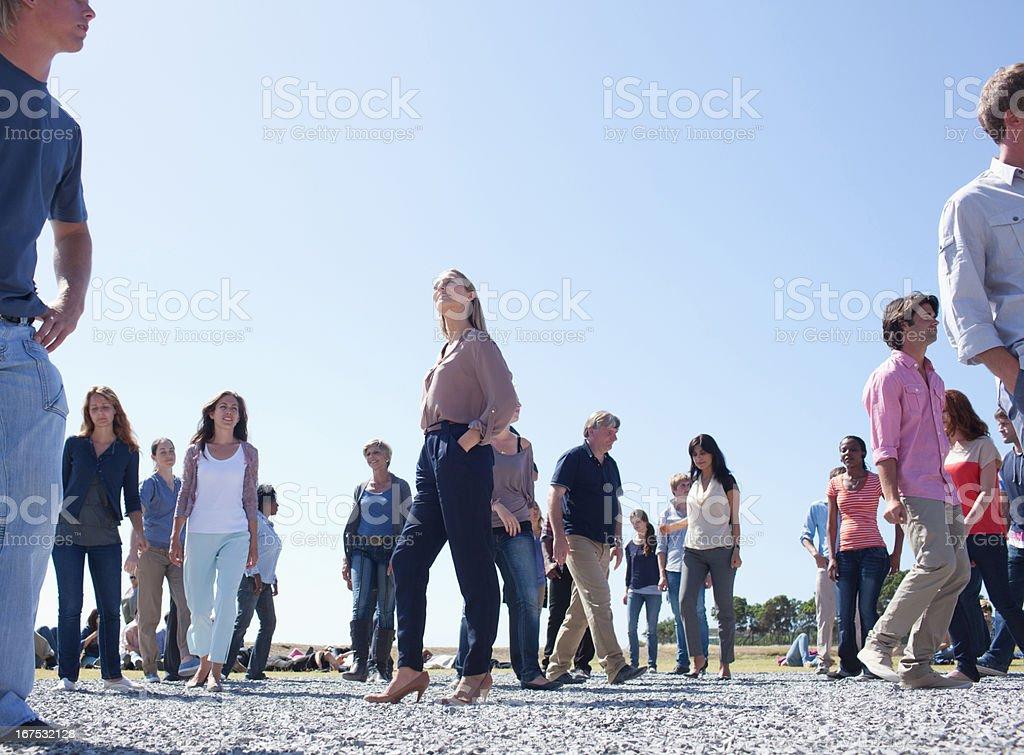 Crowd of walking people stock photo
