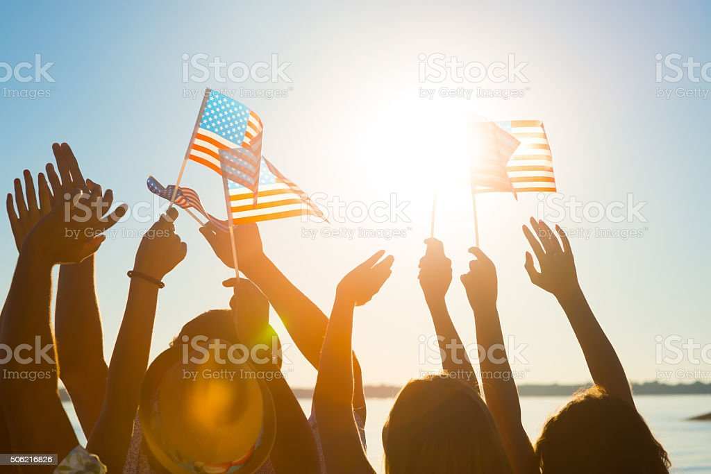 Crowd of waving American flags. stock photo
