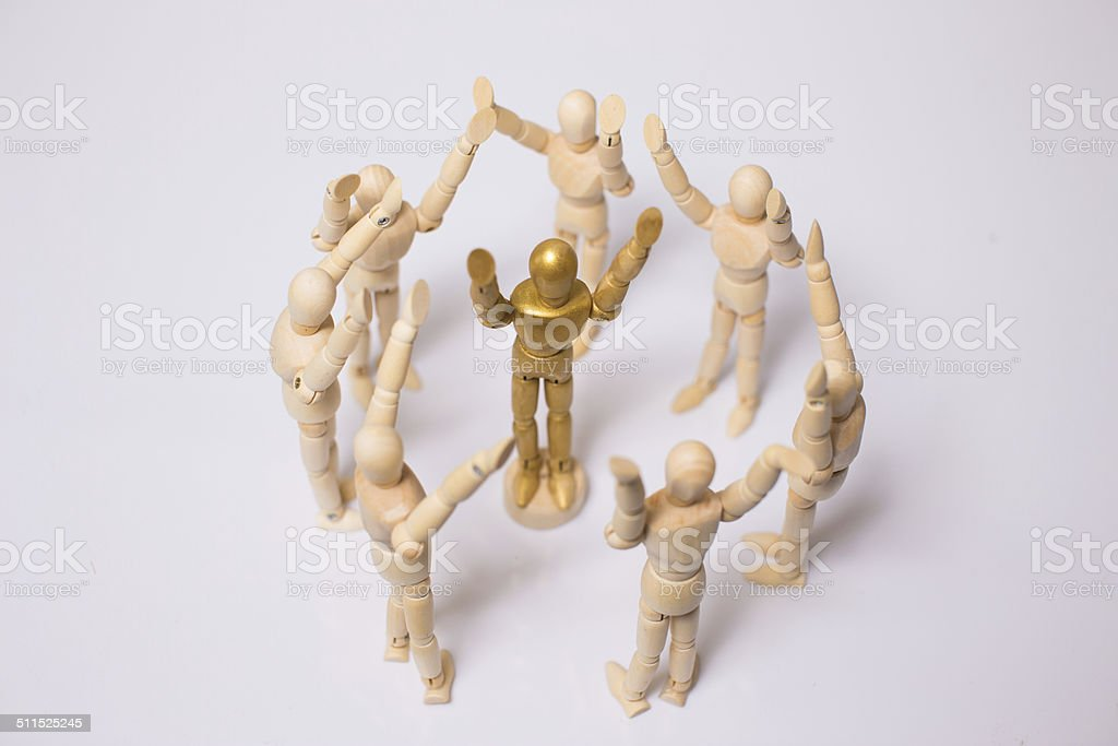 Crowd of wooden mannequin stock photo