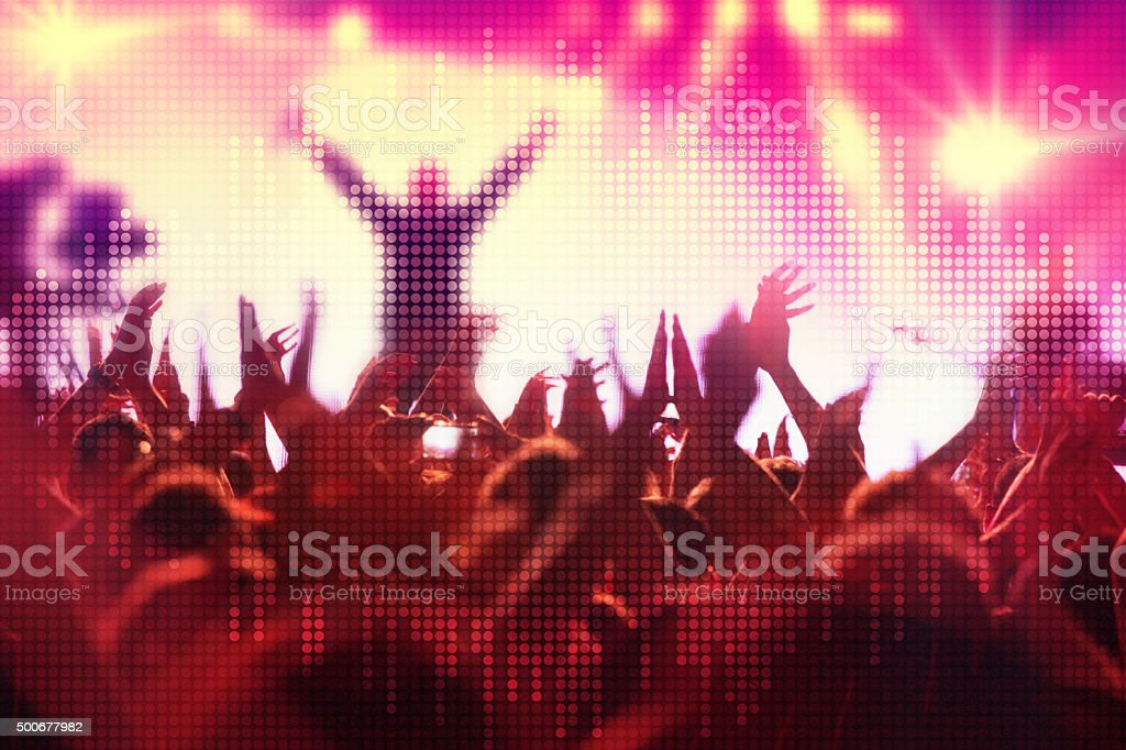 Crowd of young people at music concert with sound wave stock photo