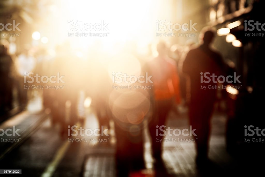 Crowd on street in bright lens flare stock photo
