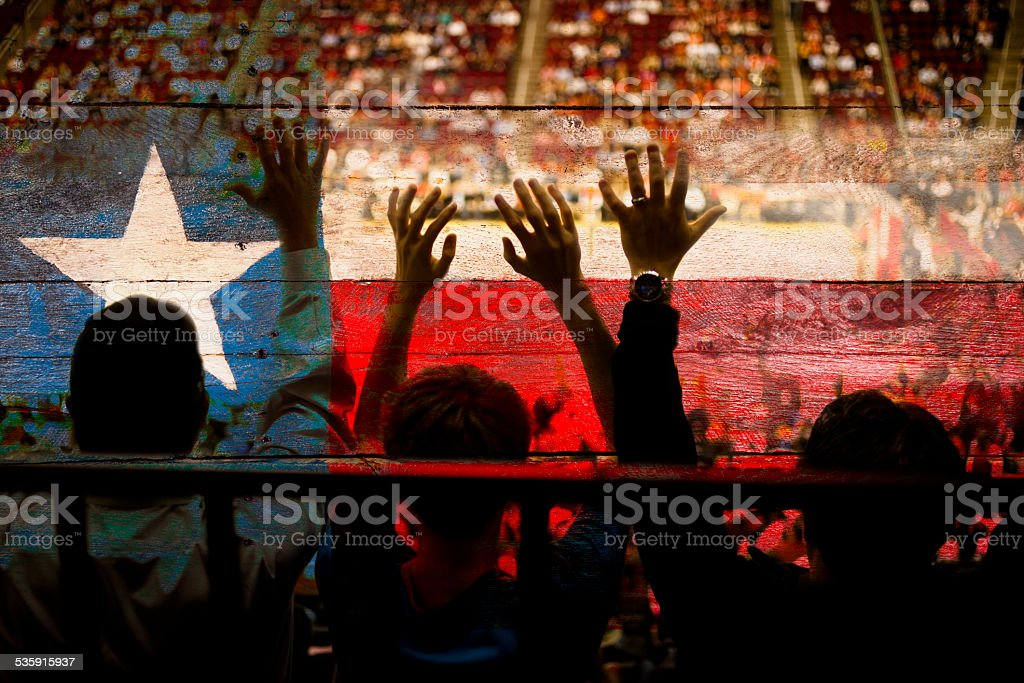 Crowd people at sports stadium. Texas flag. Basketball court. Fans. stock photo