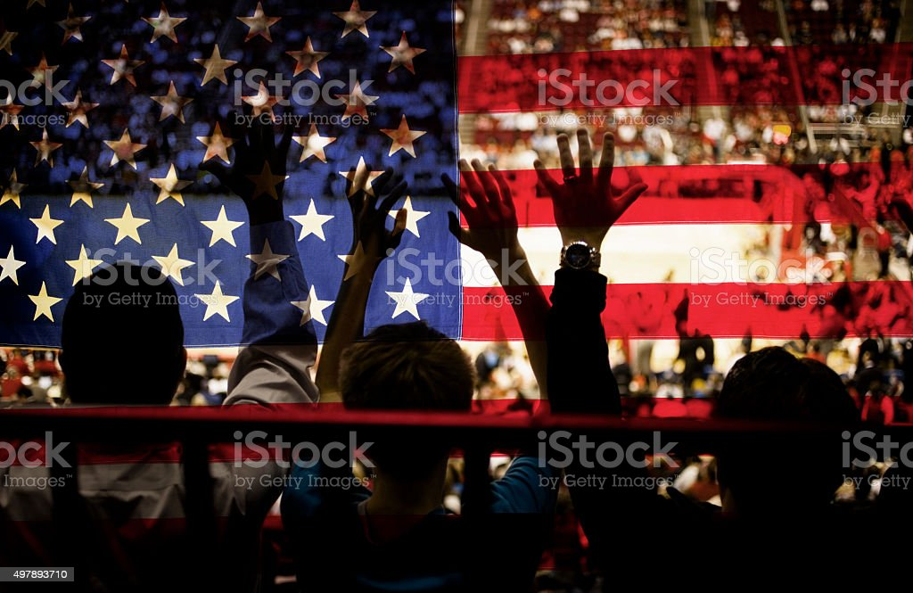 Crowd people at sports stadium. USA flag. Basketball court. Fans. stock photo