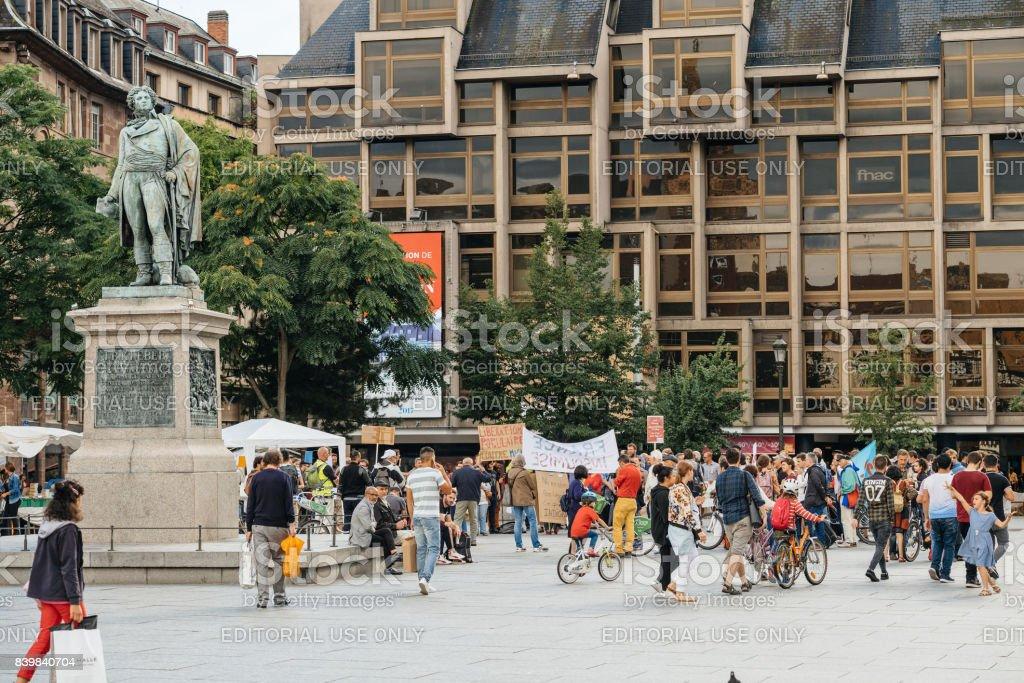 Crowd protesting in Place du General Kleber in Strasbourg, France stock photo