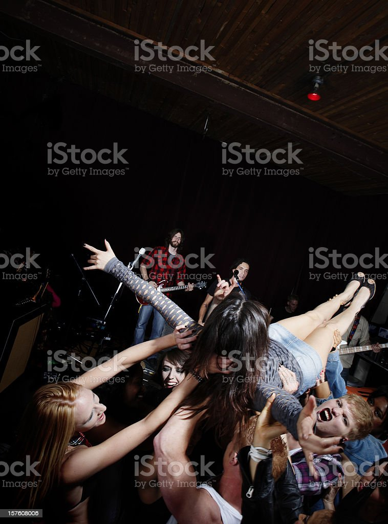 Crowd Surfing at a Rock Concert royalty-free stock photo