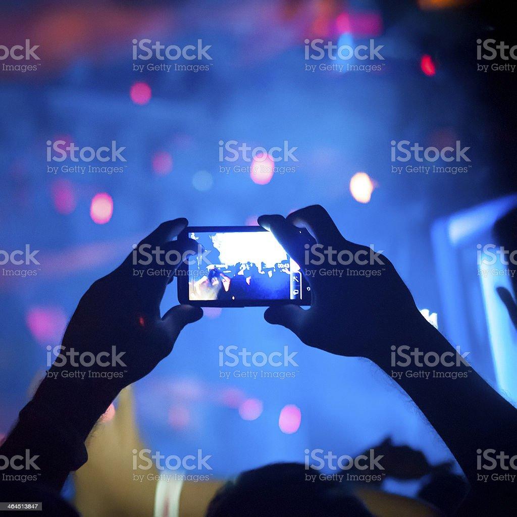 Crowd taking photos stock photo