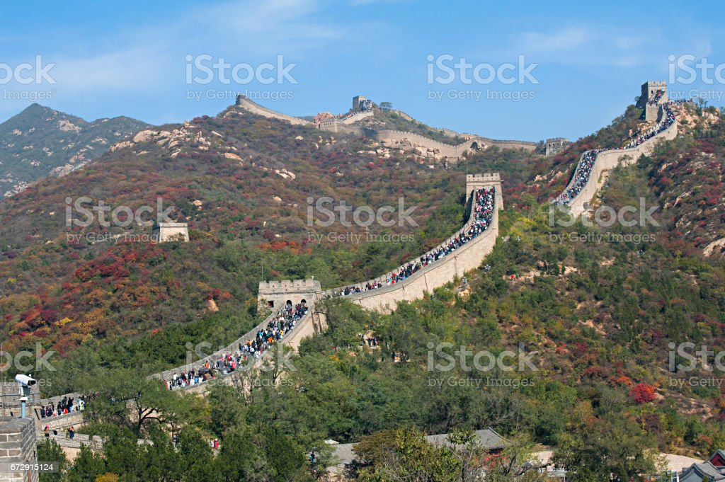 Crowd tourists climb Badaling Great Wall in autumn stock photo