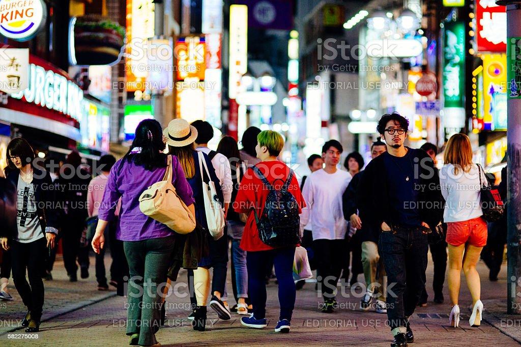 Crowd walking down the street stock photo