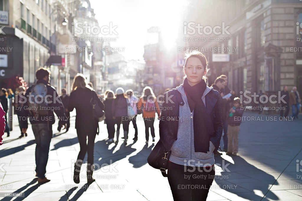 Many people stride through inner city of Vienna on an ordinary...