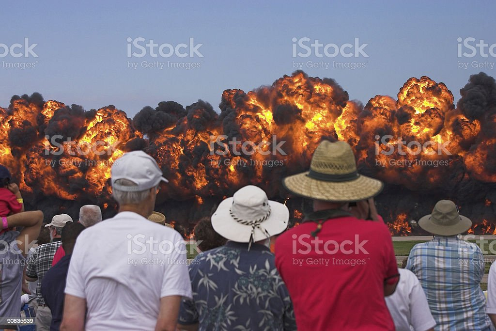 Crowd watches 100 foot high wall of fire stock photo