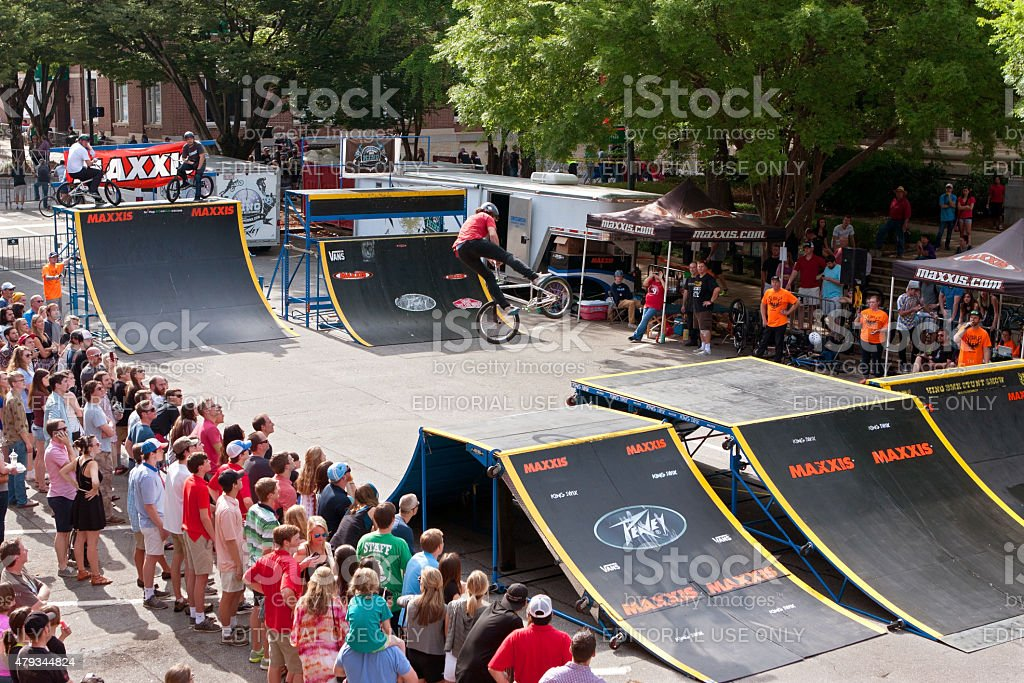 Crowd Watches BMX Pro Perform Ramp Tricks In Athens Competition stock photo