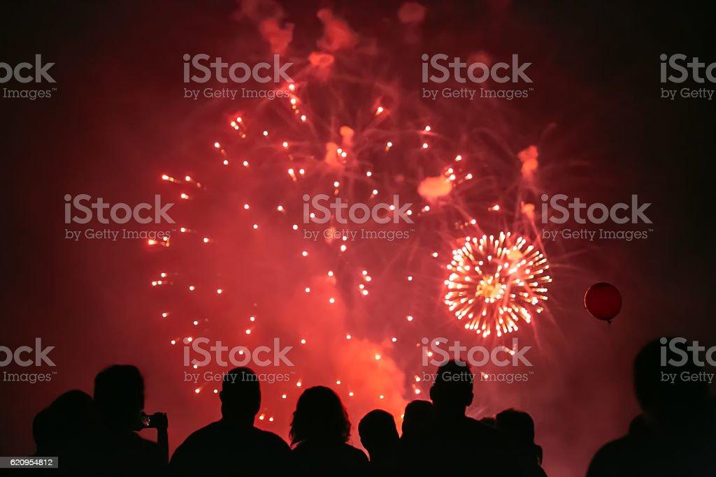 Crowd watching fireworks stock photo