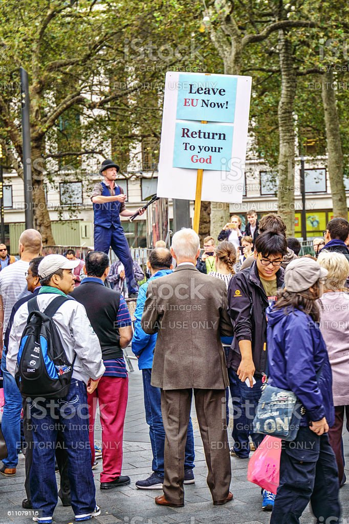 Crowd watching Street entertainer in Leicester Square London stock photo
