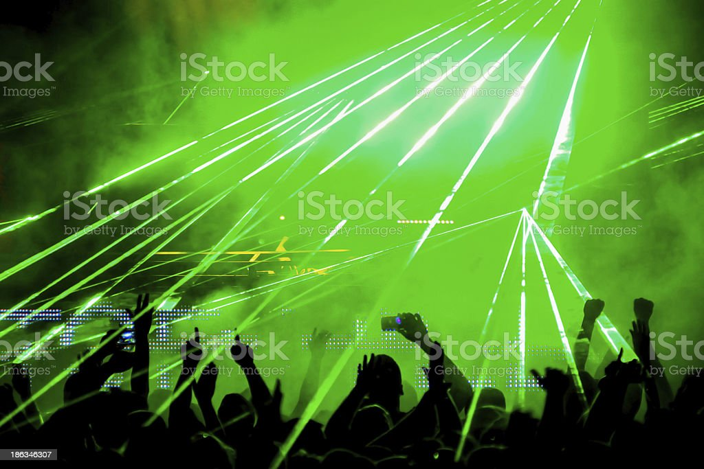 Crowd with green laser stock photo
