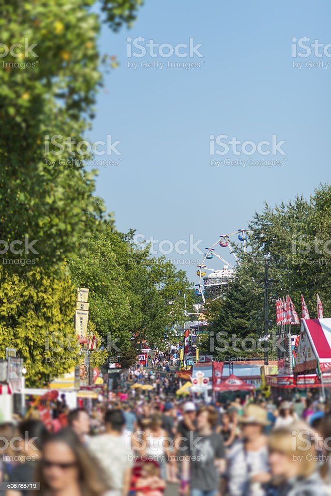Crowded Amusement Park stock photo
