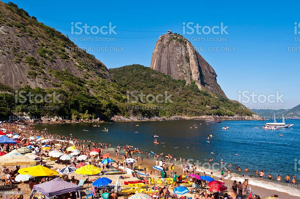 Crowded Beach and Sugarloaf Mountain stock photo