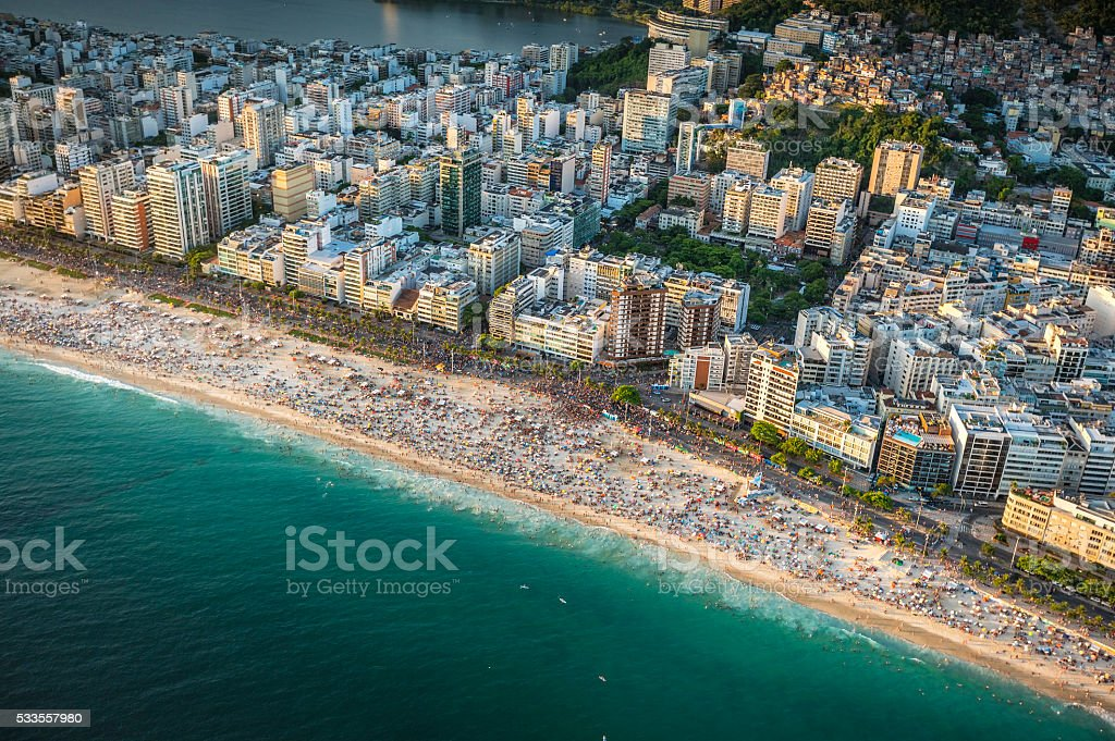 Crowded Beach in Rio de Janeiro at sunset stock photo