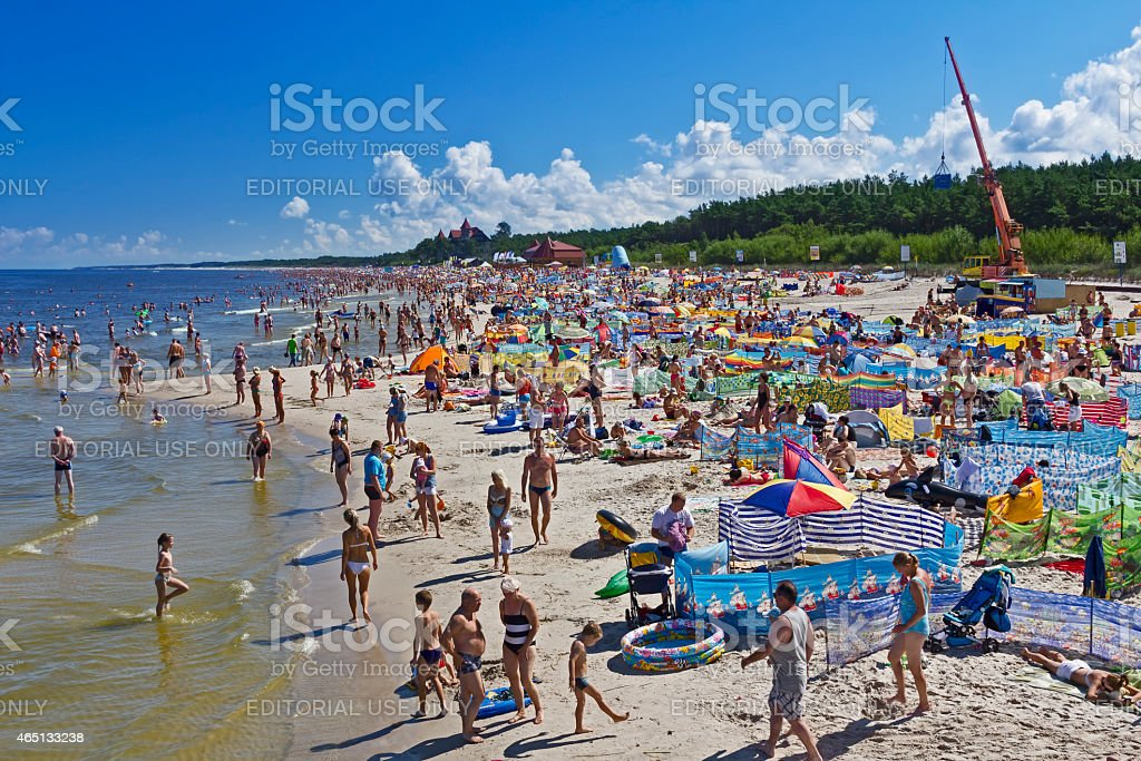 Crowded beach in summer day at Łeba Beach, Poland stock photo