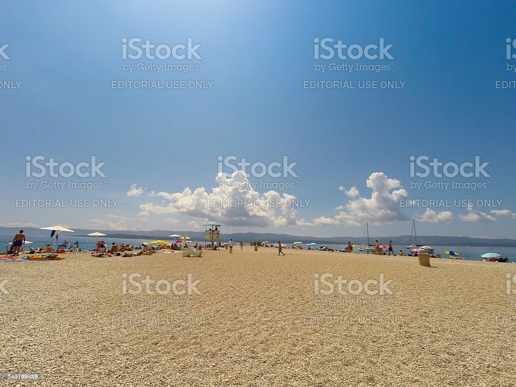 Crowded beach of Zlatni Rat stock photo